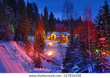 Wooden house in winter the forest