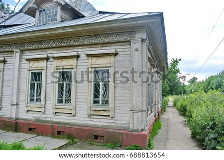 Wooden house on a city street. Old wooden houses - a monument of ancient wooden architecture of Russia. The Golden Ring Russia, Ples