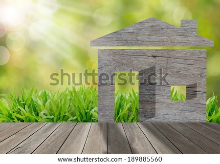 Wooden house on green grass field in morning sunlight,environment concept - stock photo
