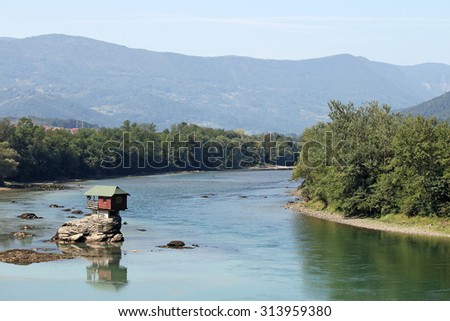 wooden house on rock Drina river Serbia - stock photo