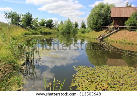 Wooden house on the lake in the Russian province