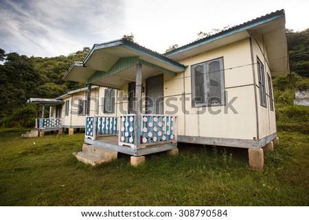 Wooden House on the shore of Rhi Lake, Burma - stock photo