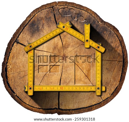 Wooden House Project Concept. Wooden house project concept. Wooden meter ruler in the shape of house in a section of tree trunk isolated on white background - stock photo