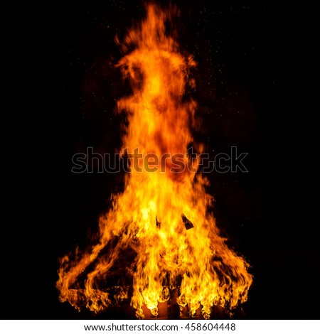 Wooden house roof in fire  on black background, dengerous concept