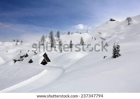 Wooden house under snow in the ski resort Vogel, Slovenia - stock photo