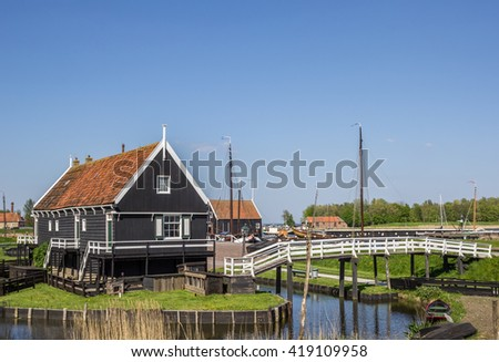 Wooden houses at the lake in Enkhuizen, Holland - stock photo