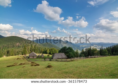 Wooden houses in the Carpathian Mountains with views of the mountains. Ukraine Synevir.