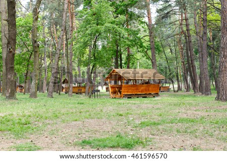 Wooden houses with barbecue in a city park for recreation