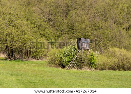 Wooden Hunters High Seat in rural Landscape, Czech Republic Scenery. Spring nature. Rural landscape. Hunting tower. Czech Republic. Beautiful countryside