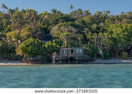 wooden hut in Kingdom of Tonga Polynesia Paradise Crystal Water Poster Panorama - stock photo