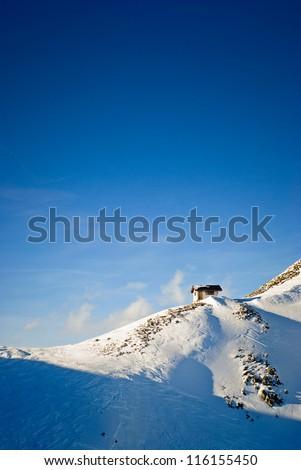 Wooden Hut on mountain range - stock photo