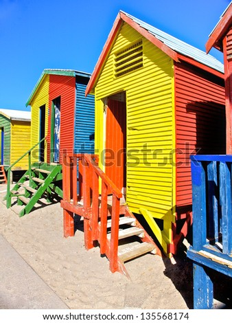 Wooden huts at St James beach in Cape Town, South Africa - stock photo