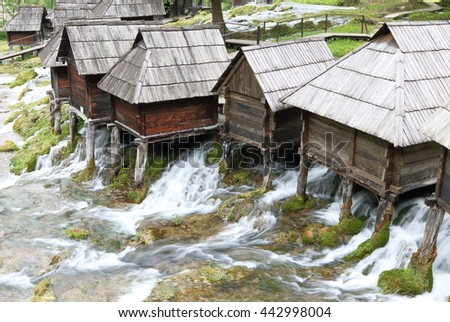 Wooden huts housing the traditional watermills at Pliva Lake in Jajce, Bosnia