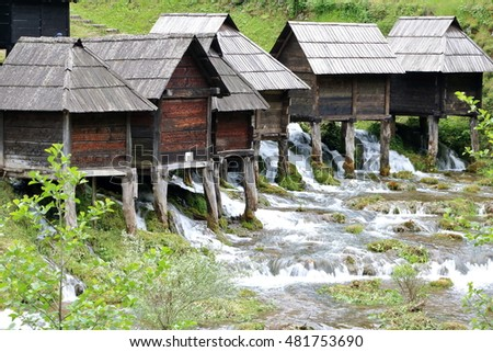 Wooden huts housing the traditional watermills at Pliva Lake, Jajce, Bosnia and Herzegovina