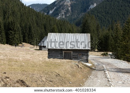 Wooden huts in Chocholowska valley in spring, Tatra Mountains, Poland