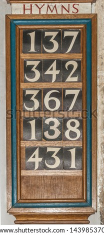 Wooden Hymn board in a Church or Cathedral - stock photo