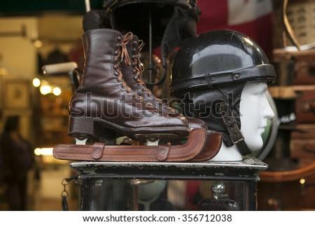 wooden ice skates and vintage at flea market - stock photo