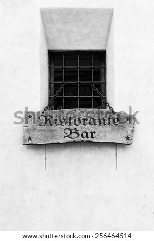 Wooden italian restaurant sign outside the window - stock photo