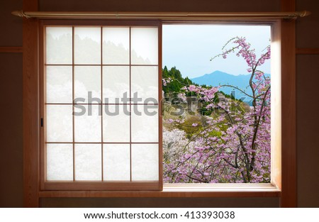 Wooden Japanese sliding window and beautiful weeping cherry tree outside - stock photo
