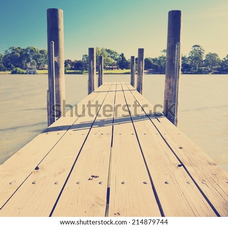 Wooden jetty along the Murray River, South Australia with Instagram style filter - stock photo