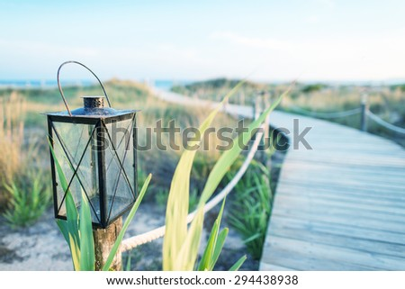 Wooden jetty at sunset. - stock photo