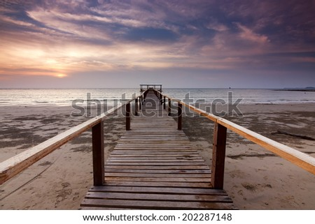 Wooden jetty at sunset in Sabah, Malaysia, Borneo - stock photo