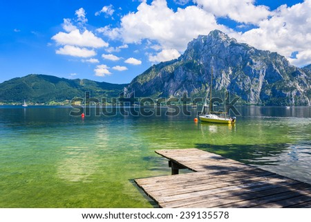 Wooden jetty for mooring yachts and boats on mountain lake, Gmunden, Traunsee, Upper Austria - stock photo