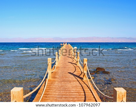 Wooden jetty stretching out into the Red Sea