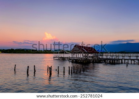 Wooden jetty with seascapes during sunset; Sarawak; Malaysia - stock photo