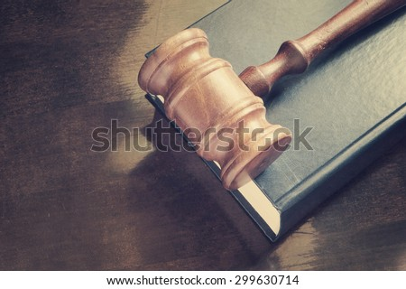 Wooden judge  gavel and legal book on wooden table - stock photo