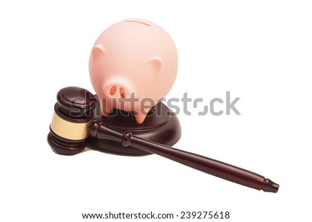 Wooden Judge Gavel And Piggy Bank on white - stock photo