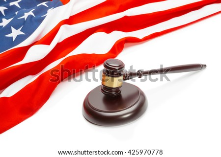 Wooden judge gavel near flag of Unites States of America - stock photo
