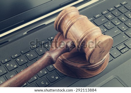 Wooden judge gavel on laptop computer - stock photo