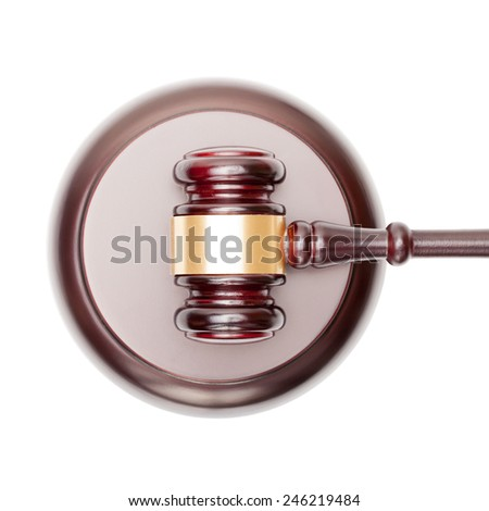 Wooden judge gavel over sound box - view from top - stock photo