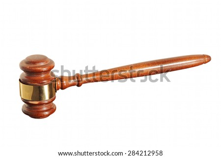 Wooden judge gavel taken closeup isolated on white background.