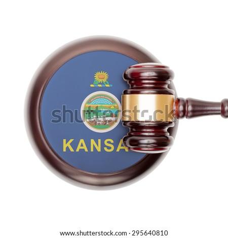 Wooden judge gavel with USA state flag on sound block - Kansas - stock photo