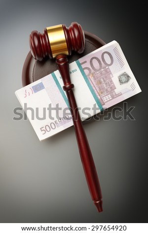 Wooden judge's gavel and money - stock photo