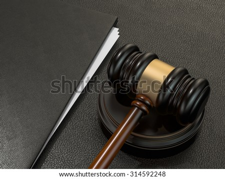 Wooden judges gavel and leather folder on black leather desk. High resolution - stock photo