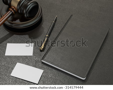 Wooden judges gavel and notebook, business cards on black leather desk. High resolution - stock photo