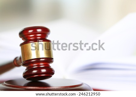 Wooden judges gavel, close up - stock photo