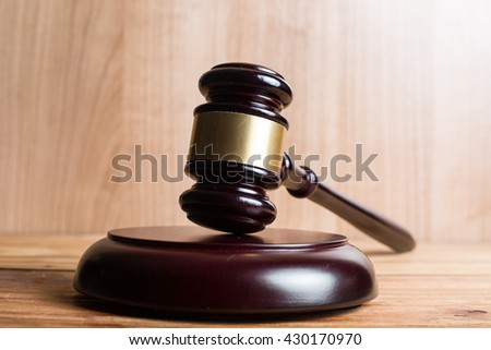 Wooden Judges gavel ,golden scales justice with black background.