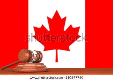 Wooden Justice Gavel with Flag Of Canada - stock photo