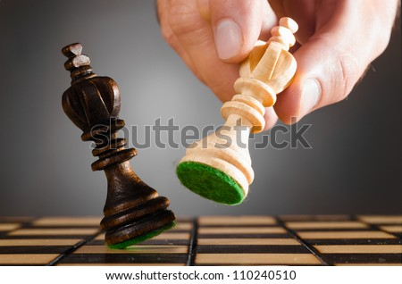 wooden kings on gray background - stock photo