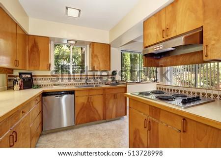 Wooden Kitchen Cabinets, Steel Stove And Backspalsh. House Interior.  Northwest, USA