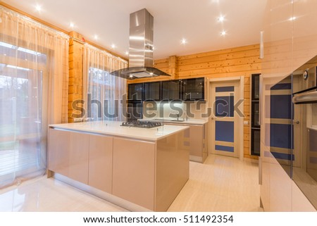 Wooden kitchen room interior with modern steel appliances