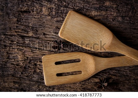 Wooden kitchen spoon in dark tone. still life photography.
