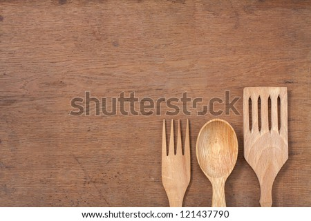 Wooden kitchen spoons, forks on oak wood table background - stock photo