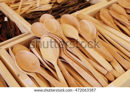 Wooden kitchen spoons on wooden