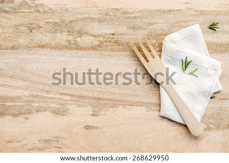 Wooden kitchen table from above with copy space. rosemary on wood table. kitchen photo for recipe book or advertisement. - stock photo