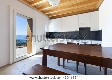 wooden kitchen table, rural home interior - stock photo